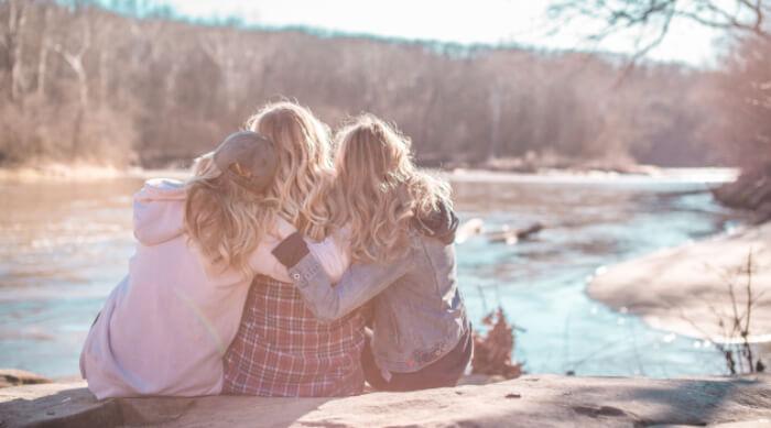 Unsplash: three girls hugging each other