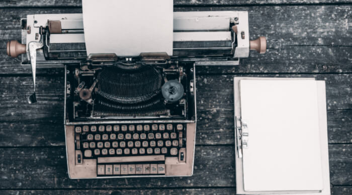 Typewriting with clipboard beside it