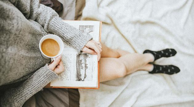 Unsplash by Anthony Tran - Girl with coffee reading a book