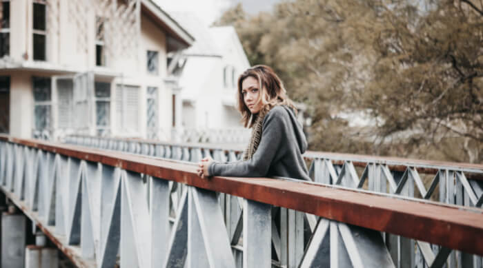 Unsplash: woman standing on a bridge