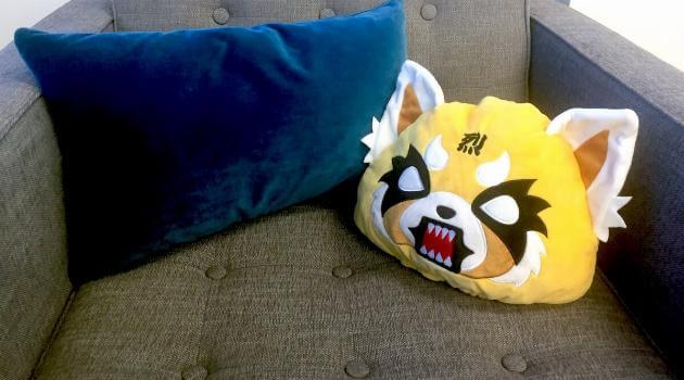 aggretsuko-metal-pillow-on-couch-articleH-120418