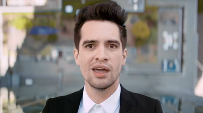 """Brendon Urie climbing up the side of a building in Panic! At the Disco's """"High Hopes"""" music video"""