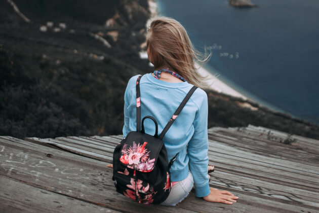 girl-sitting-on-a-scenic-overlook-article-121018