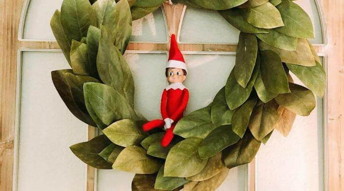 Instagram: Elf on the Shelf in a Christmas wreath