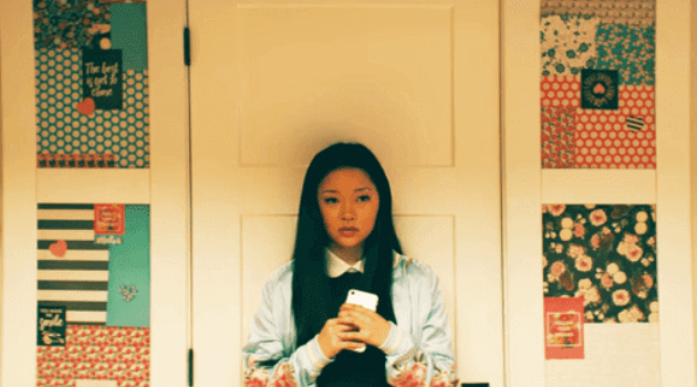 Lara Jean on her phone after going to a party with Peter in To All the Boys I've Loved Before