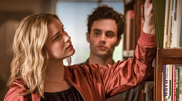 Penn Badgley creepily staring at a blonde girl in the Lifetime TV series You