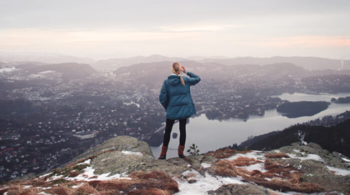 Woman standing on the edge of a scenic outlook