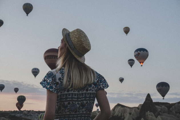 woman-watching-balloons-article-121018