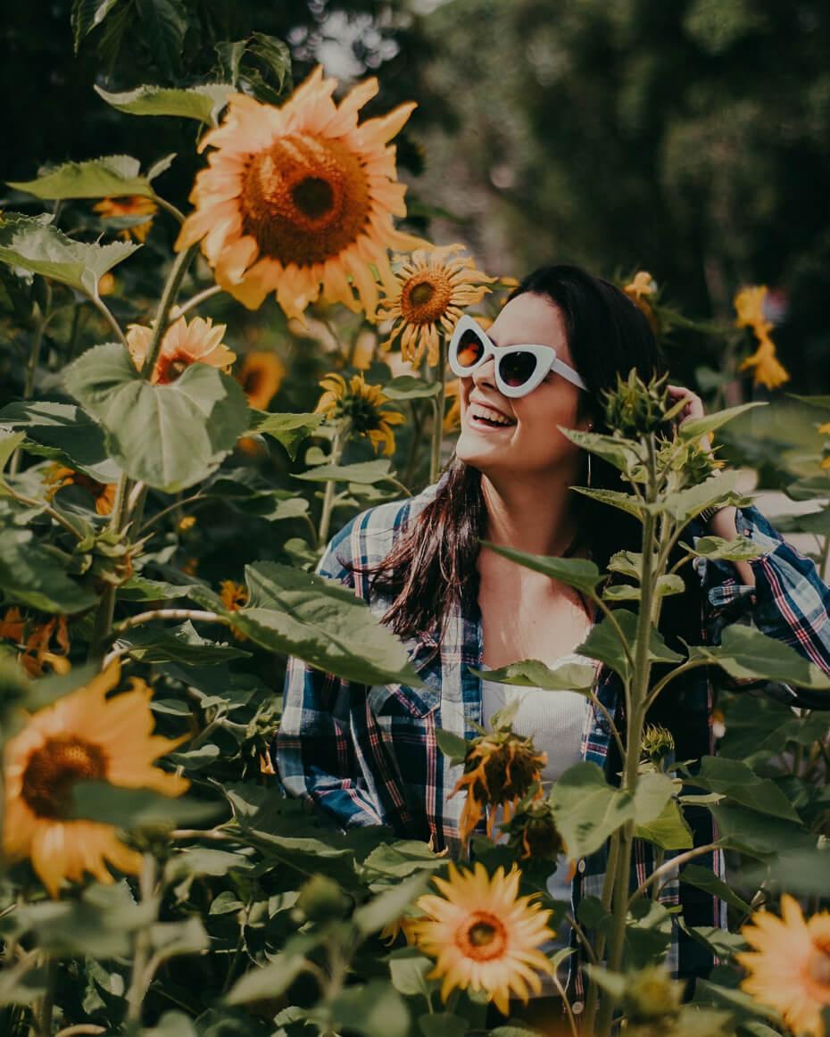girl smiling in sunflowers