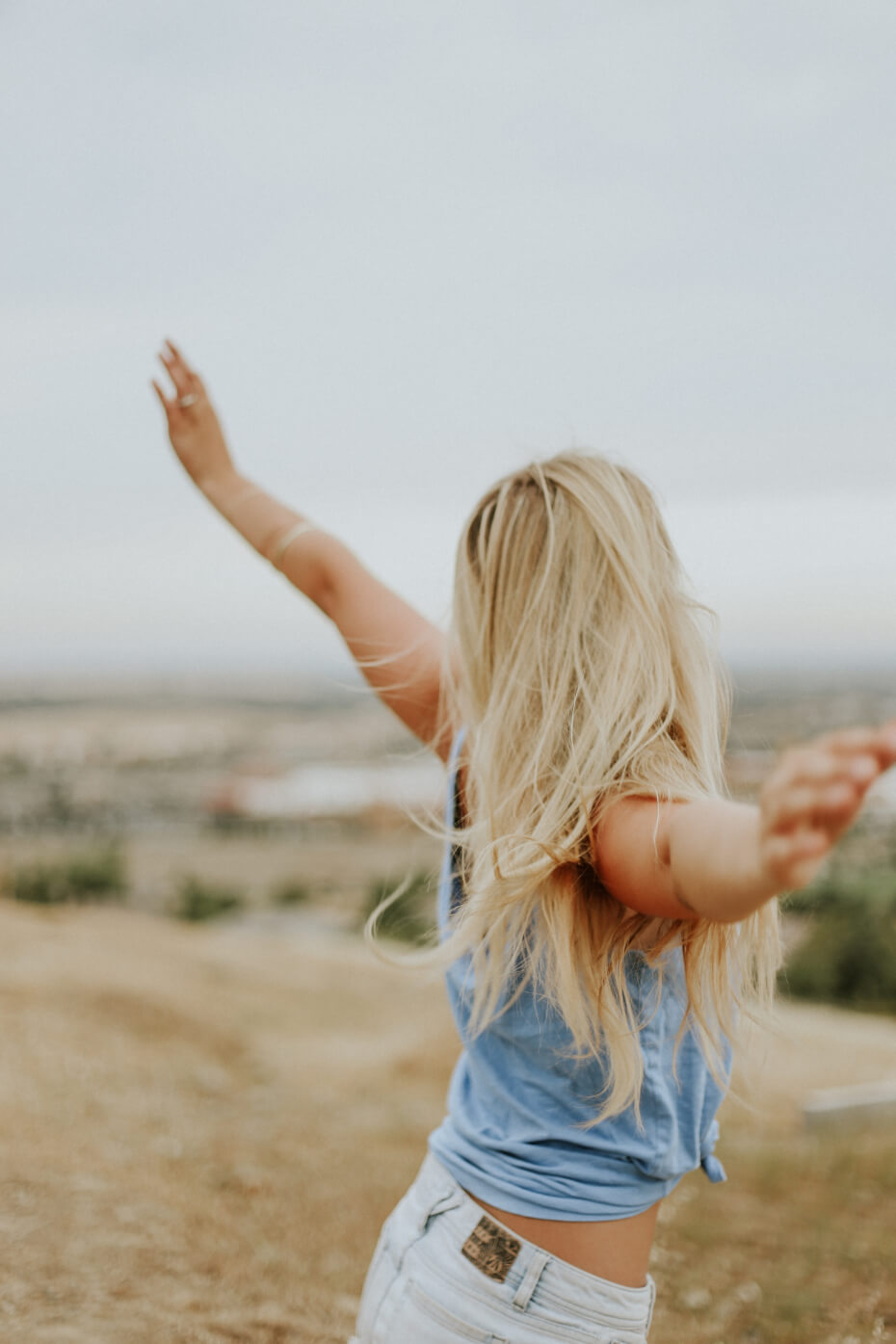 girl with outstretched arms