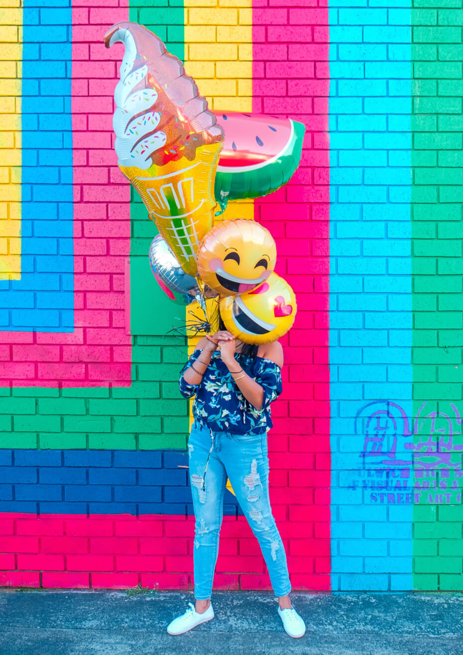 girl with happy balloons