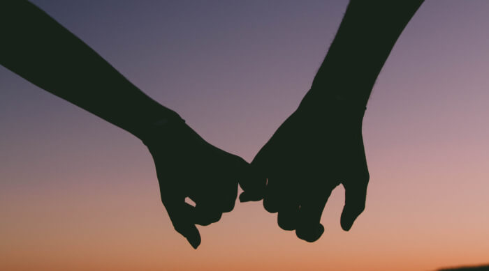 hands holding at sunset
