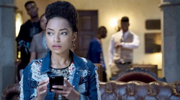Sam White getting a text in Netflix's Dear White People