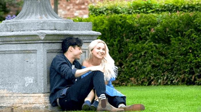 Dove Cameron and her boyfriend in a garden