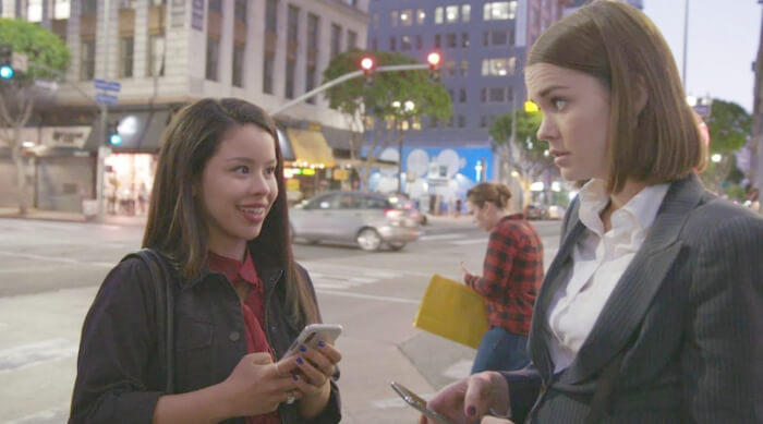 Mariana and Callie texting each other while in DTLA on an episode of Good Trouble