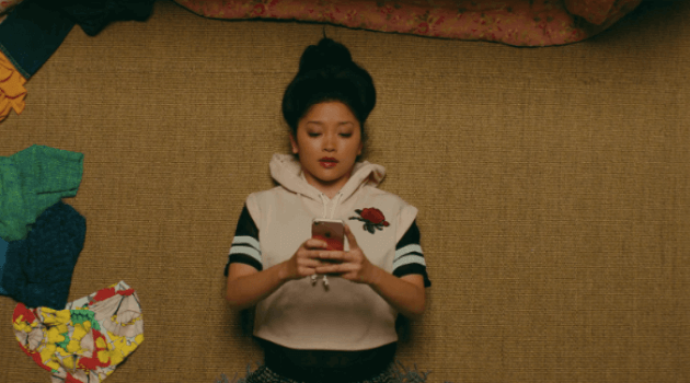 to all the boys i've loved before: lara jean laying on the ground texting