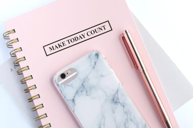 """Unpslash: Phone and pen on top of """"Make Today Count"""" planner"""