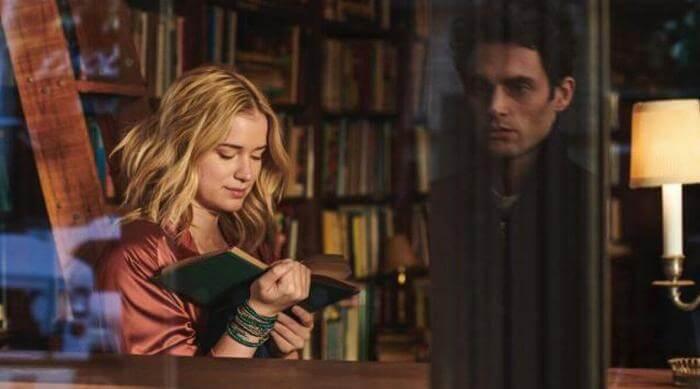 Joe watching Beck read through a glass window on You