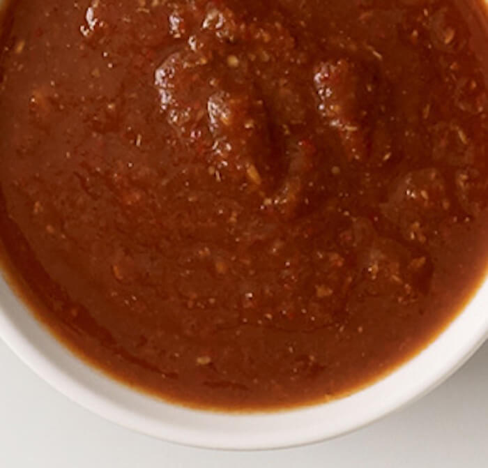 Chipotle: Tomatillo red chili salsa