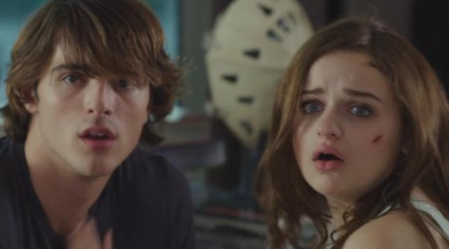 Elle and Noah looking shocked after Lee catches them making out in The Kissing Booth