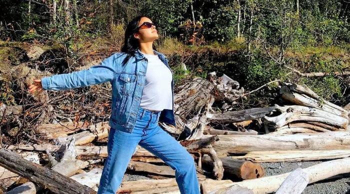 Instagram: Camila Mendes wearing denim in the forest