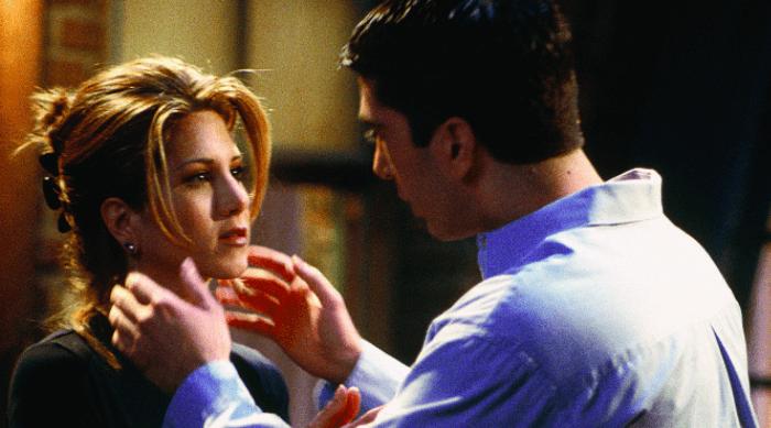 Ross grabbing Rachel's face