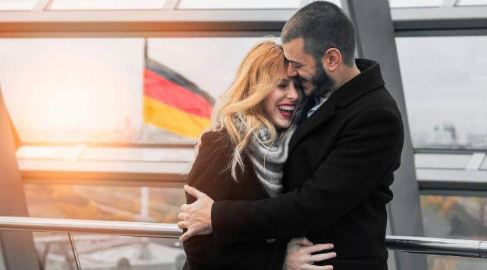 Shutterstock: Couple laughing and hugging in Germany