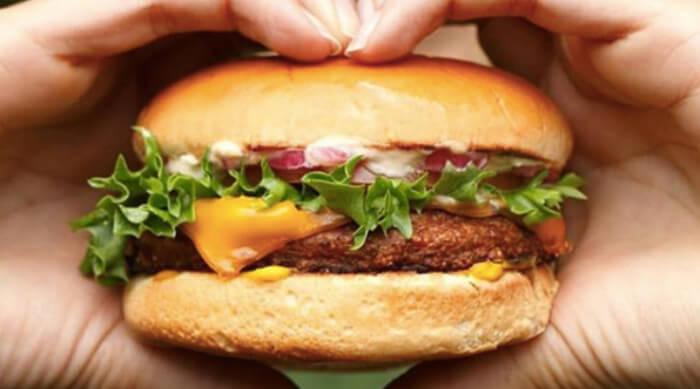 Woman holding a Beyond Burger between her hands