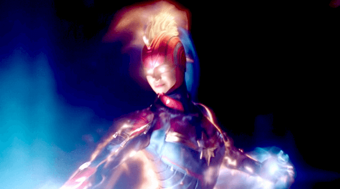 Captain Marvel: Carol Danvers in her red and blue suit with mohawk in space