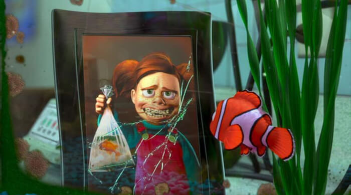 Nemo staring at a photo of Darla holding a dead fish in a bag in Finding Nemo