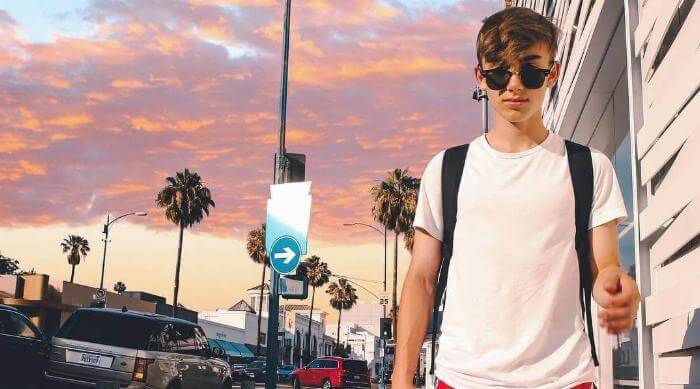 Instagram: Johnny Orlando walking in L.A. with pink sunset