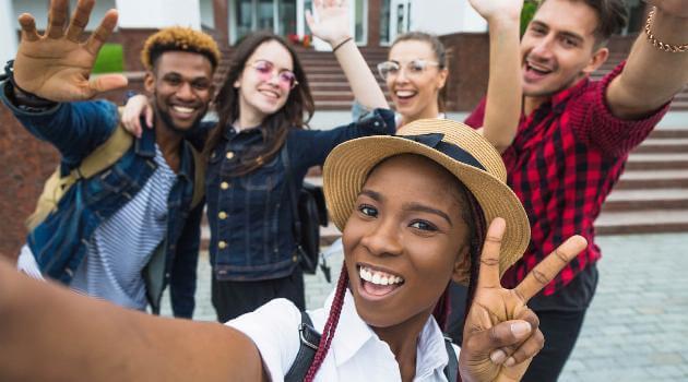 Shutterstock: Group of friends taking selfie