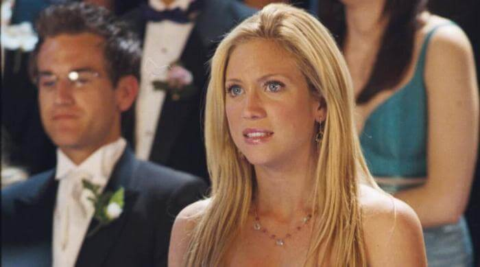 Brittany Snow with an awkward smile on her face in the movie 'Prom Night'