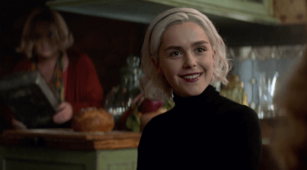 CHILLING ADVENTURES OF SABRINA - SABRINA SITTING AT THE BREAKFAST TABLE