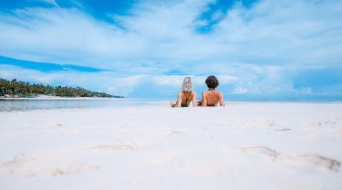 UNSPLASH - COUPLE SITTING TOGETHER ON WHITE BEACH
