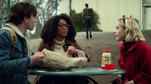 Harvey, Roz and Sabrina all eating lunch together in Chilling Adventures of Sabrina