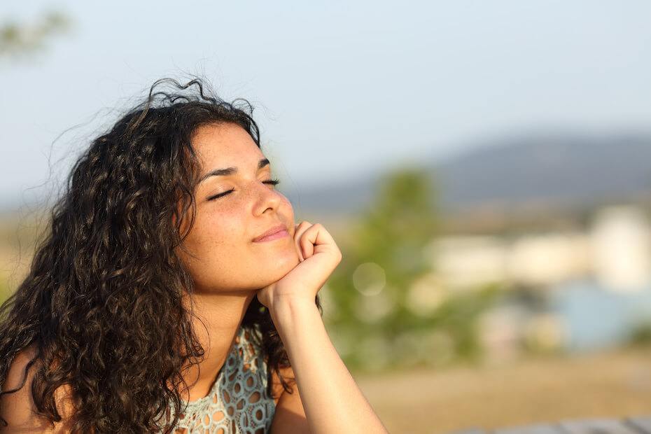 shutterstock-woman-smiling-contentedly-in-sun-alone-031920
