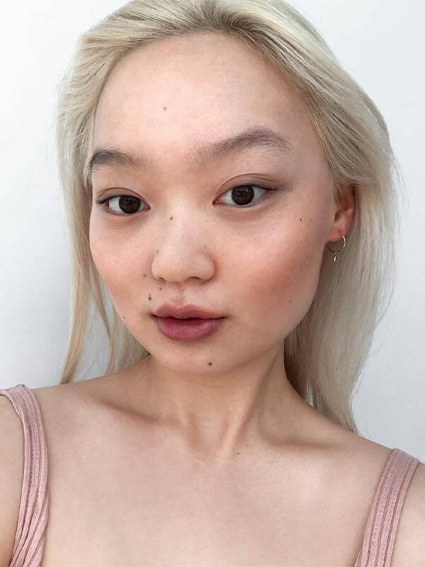 Model wearing Glossier