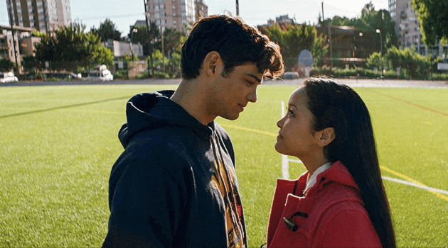 Peter and Lara Jean standing on the lacrosse field at the end of 'To All the Boys I've Loved Before'