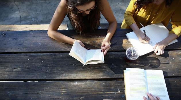 unsplash-alexis-brown-woman-reading-writing-around-table-articleH-060319