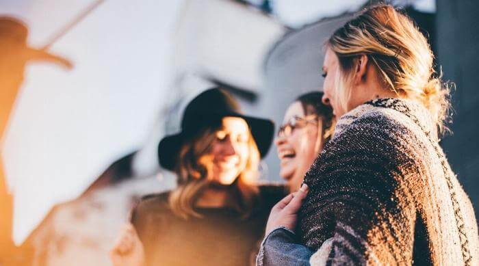 Unsplash: Group of women laughing and meeting with each other