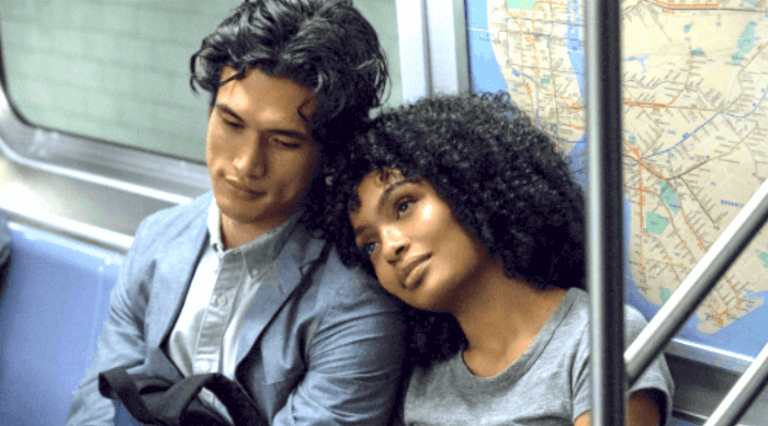 THE SUN IS ALSO A STAR - NATASHA AND DANIEL SITTING ON THE SUBWAY