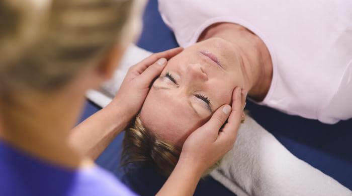 Shutterstock: Alternative medicine healing hands on head