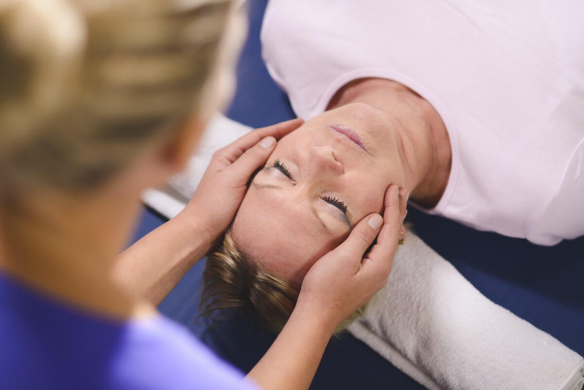 shutterstock-alternative-medicine-healing-hands-on-head