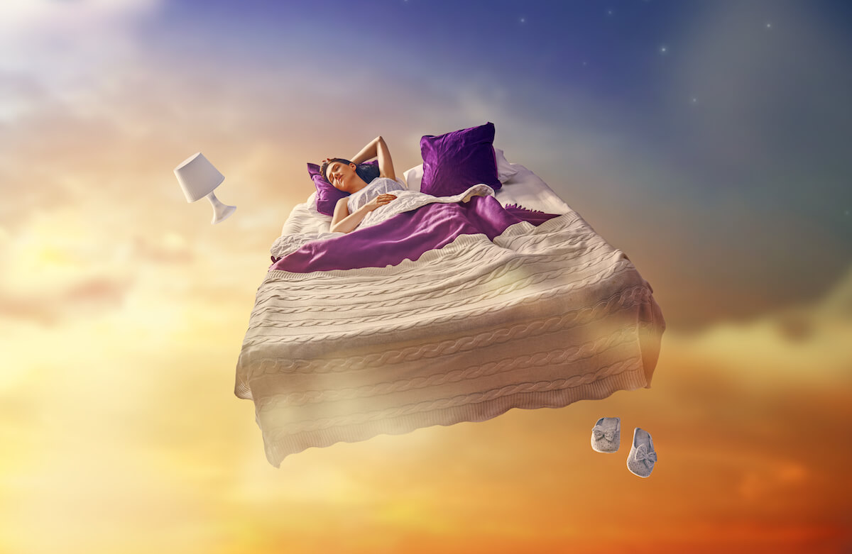 Unsplash: Woman dreaming with her bed floating in the sky