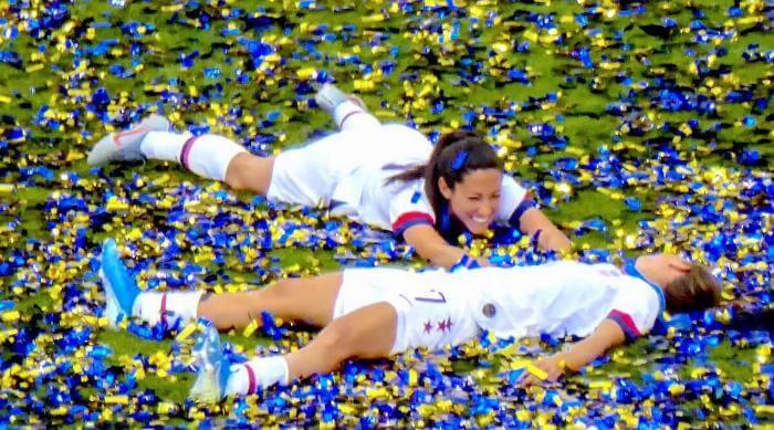 US Women's Soccer Team celebrate in confetti Christen Press and Tobin Heath
