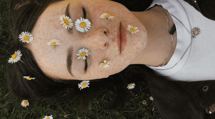 cute girl with freckles and flowers on her face