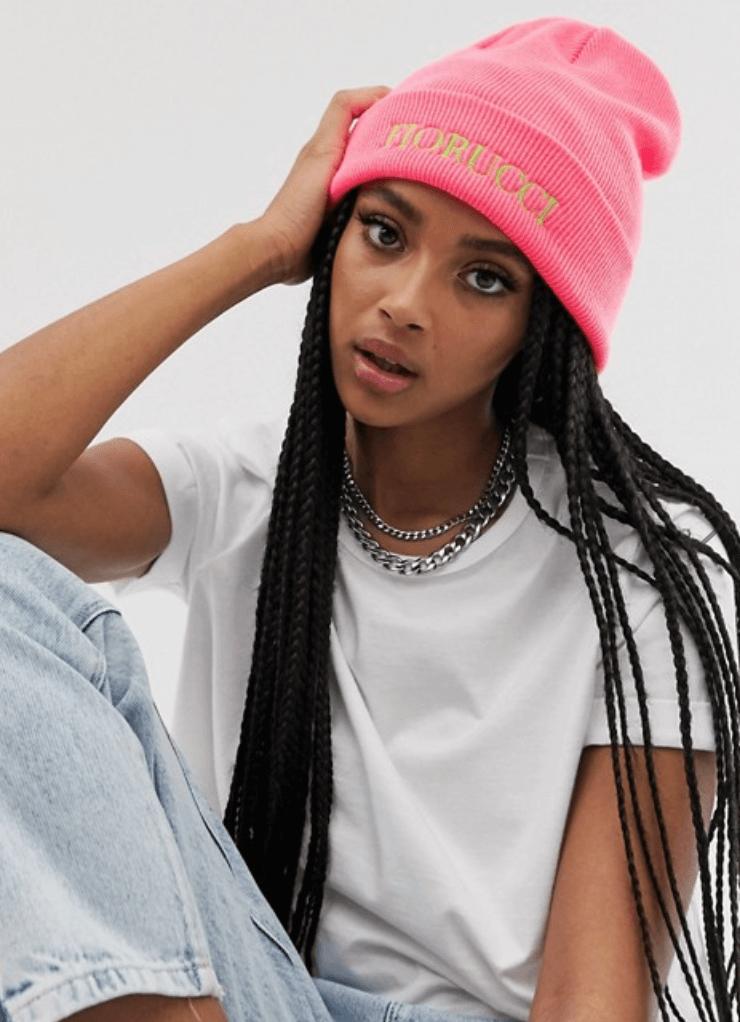 girl wearing fiorucci pink beanie