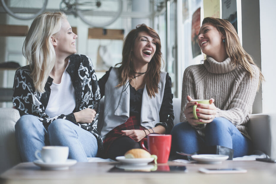 shutterstock-3-friends-laughing-drinking-coffee-080619