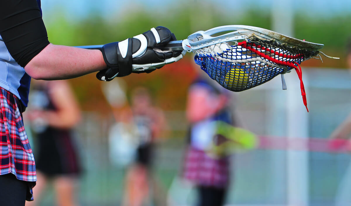 shutterstock-girls-lacrosse-player-with-ball